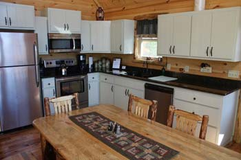 cabin fully equipped kitchen with amenities