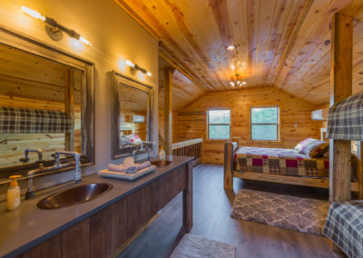 Upstairs Vanity And Queen Bed Hideaway At Clear Sky Ridge Cabin Rentals Near Wolf Pen Gap In Mena Arkansas